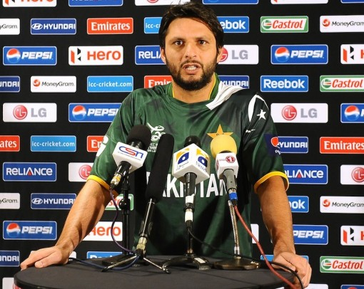Pakistan cricketer Shahid Afridi talks to the media during the open media sessions ahead of the ICC Twenty20 Cricket World Cup in Colombo on September 13, 2012.  The two-yearly tournament in cricket's shortest format will be played from September 18 to October 7, with Hambantota holding three matches, Pallekele nine and capital Colombo fifteen.  AFP PHOTO/ LAKRUWAN WANNIARACHCHI        (Photo credit should read LAKRUWAN WANNIARACHCHI/AFP/GettyImages)